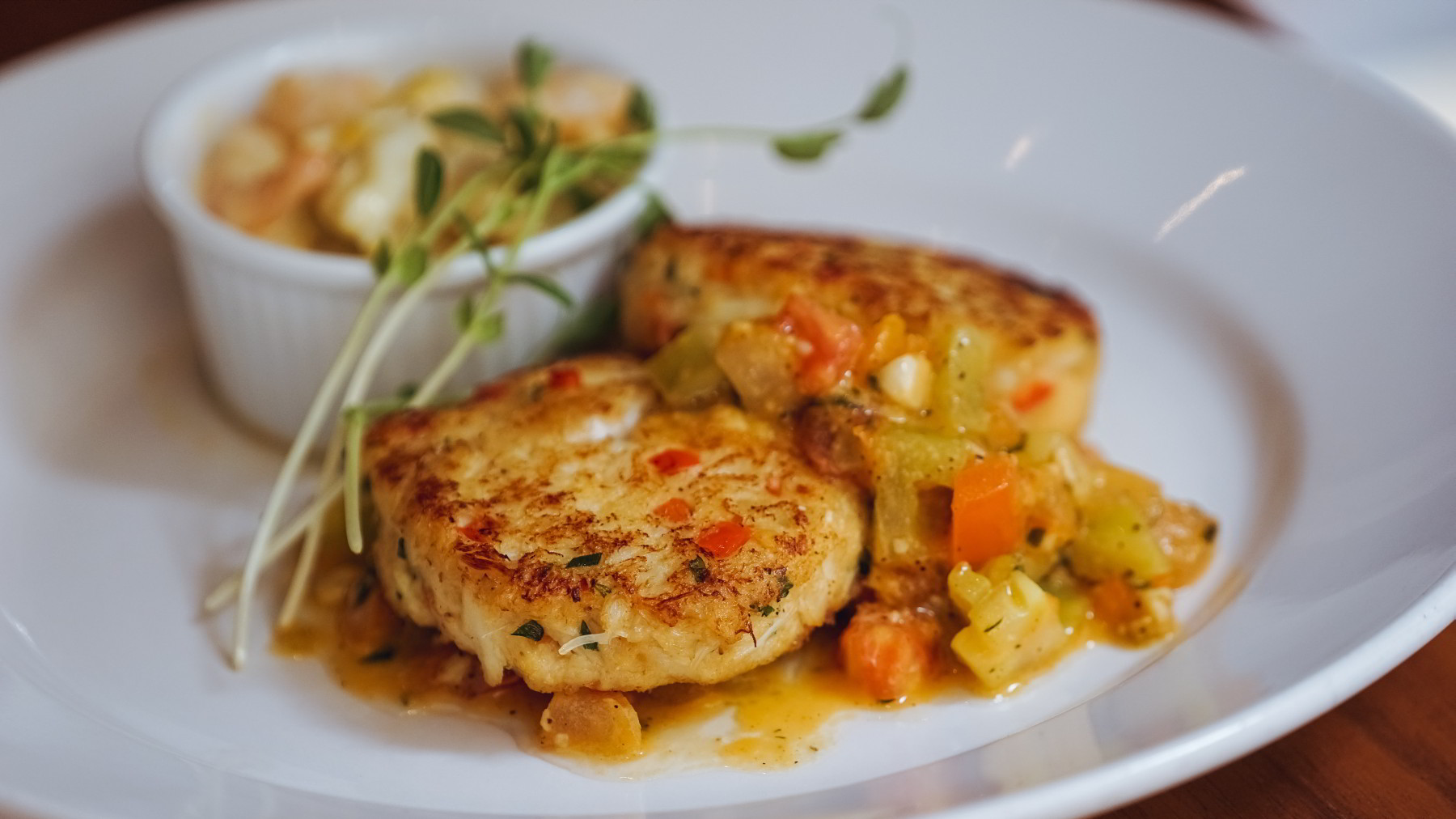Jumbo Lump Crabcakes with Red & Yellow Tomato Concasse, Hot Crab, Shrimp & Artichoke Dip